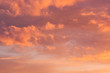 Idyllic sunshine sky with golden and pink clouds in blue sky as abstract texture, background.