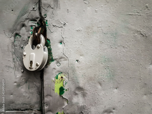 close up. padlock on painted iron door.