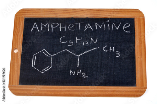 Photo School slate on which is written the chemical formula of amphetamine