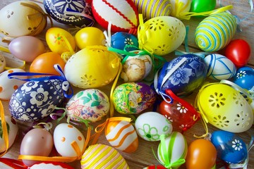 Fototapeta na wymiar Many beautiful painted colourful Easter eggs stacked on a table