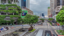 Traffic With Cars On A Street And Urban Scene In The Central District Of Singapore Timelapse