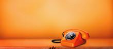 Orange Phone On An Orange Background