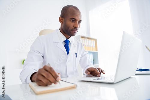 Fotografie, Tablou Photo of family doc dark skin guy watch notebook webinar medical reform cov vira