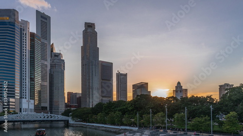 Singapore skyscrapers skyline with white Anderson Bridge near esplanade park day to night timelapse Wallpaper Mural