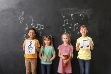 Little Children Near Chalkboard At Music School
