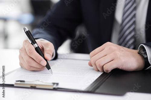 書類にサインする日本人男性ビジネスマンの手元 Canvas Print