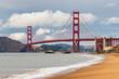Golden Gate Bridge at sunset from sandy beach, San Francisco, California.