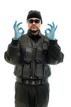 Concept Isolated Portrait On A White Background Man In Black Police Special Forces Uniform In Medical Gloves