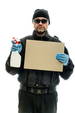 Concept Isolated Portrait On A White Background Man In Black Police Special Forces Uniform In Medical Gloves And Cleaning Supplies And Banner In Hands