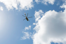 Helicopter In Flight Against A...