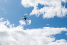 Helicopter In Flight Against A Cloudy Sky
