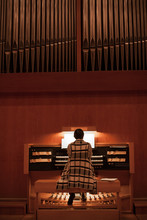 Organist Playing A Pipe Organ