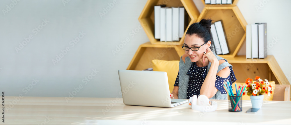 Fototapeta Happy excited successful Beautiful businesswoman triumphing in modern office with laptop, success happy pose. Work from home and social distancing concept