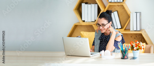 Happy excited successful Beautiful businesswoman triumphing in modern office with laptop, success happy pose Fototapet