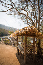 Tropical Wooden Gazebo With A Thatched Roof On The Observation Deck. Place To Stay In The National Park Of India On The Falls Athirapilly