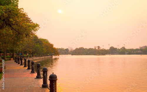 Lake side public park in summer evening Poster Mural XXL