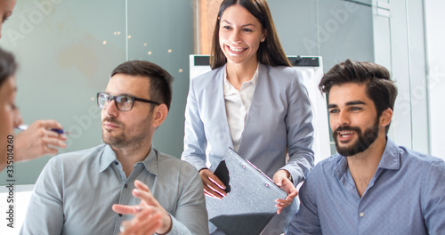 Fototapeta Beautiful businesswoman on meeting with business partners in the office obraz