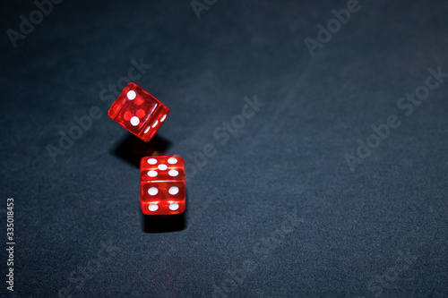 freeze red dice in motion on a dark background with copy space Wallpaper Mural