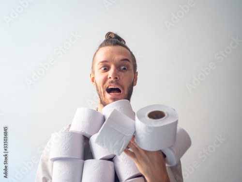 Fotografía Young Blond Hair Caucasian Male Hoarding Toilet Paper for Covid-19 Looking at th