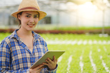 Young Beautiful Farmer Use Tablet And Smart Device With Technology To Automatic Control Her Hydroponics Farm And Agribusiness With Happy And Smile, New Generation Farmer