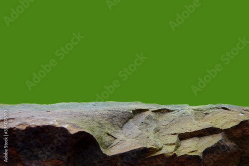 Photo A Rock Mineral, Showing a Rough Texture to the Horizontal Ledge of the Stone Shelf