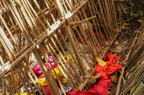 Grave of bamboo sticks in cemetery in Terunyan village Canvas Print