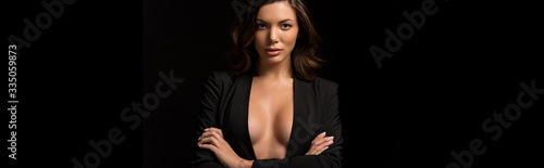 panoramic shot of confident, seductive girl in unbuttoned blazer posing with cro Canvas Print