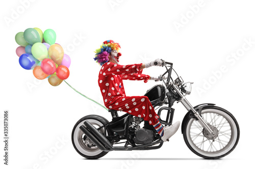 Photo Clown riding a chopper motorbike with a bunch of balloons