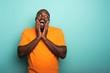 Joyful and happy afro guy over cyan background