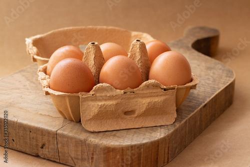 Half a dozen brown eggs