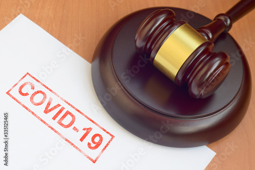 Justice mallet and blank document with Covid-19 red stamp Canvas Print