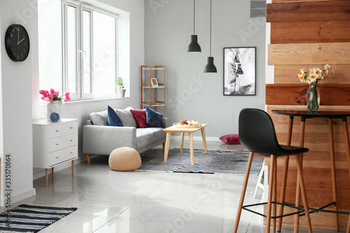 Obraz Interior of beautiful modern studio apartment - fototapety do salonu