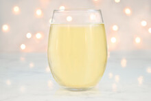Stemless Wine Glass Mockup With Glowing Bokeh Lights