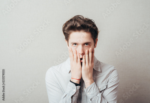 Valokuva Worried or ashamed man covering his face with hand