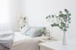 Leinwandbild Motiv eucalyptus and gypsophila  in vase in white bedroom