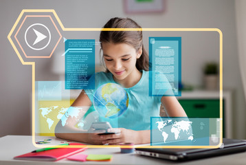 school, technology and distant education concept - smiling girl with smartphone and hologram projection of earth planet or globe learning geography online at home