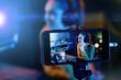 Leinwanddruck Bild - Young woman streaming a live video