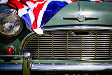Classic Car With Union Jack Flag Draped Over The Bonnet.