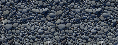 Fotomural Black pebbles background. Banner texture