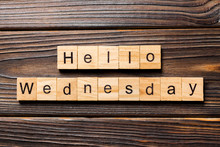 Hello Wednesday Word Written On Wood Block. Hello Wednesday Text On Wooden Table For Your Desing, Concept