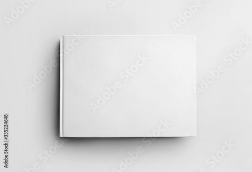 Fotografie, Obraz Mockup blank white closed book isolated on background, front view