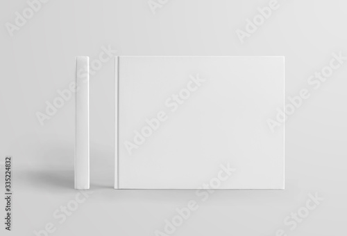 Fotografering Set of standing white hardcover books landscape orientation, front and side view, isolated on background