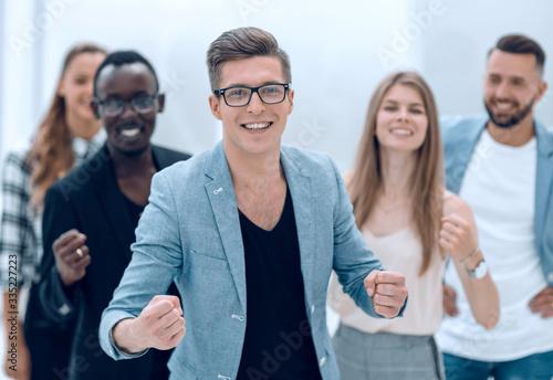 Vászonkép successful multinational business team showing thumb up
