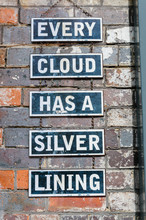 "Signs On A Brick Wall Saying ""..."