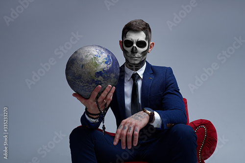 Photo Satan holds the world in his hands