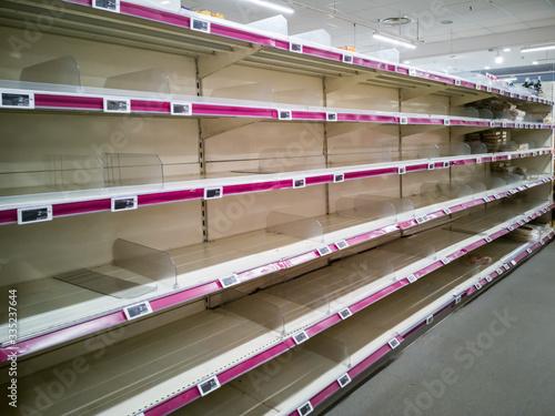 Empty shelves in supermarket store due to coronavirus covid-19 outbreak panic Tapéta, Fotótapéta