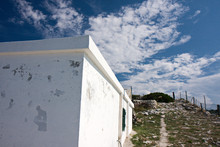 White Building On The Cliff By The Mediterranean Sea.