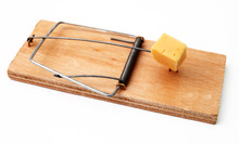 Mouse Trap With A Piece Of Cheese On A White Background Close-up