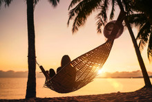 Young Woman Relaxing In Hammoc...