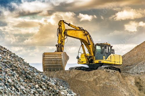 Excavator on the road construction works Fototapeta